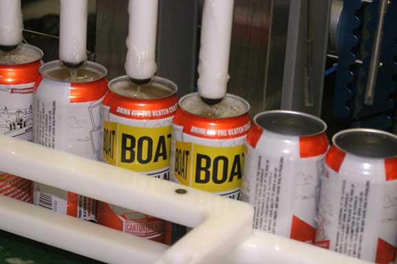 Canning Boat beer at Carton Brewing, October 1, 2013. This was the second run of Boat in cans.